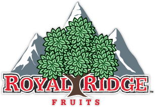 This is Royal Ridge Fruit's logo which displays an illustration of a fruit tree between the words Royal Ridge Fruits over illustrated mountains in the background.